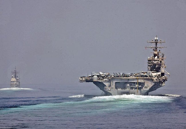 U.S. Navy photo of the USS Abraham Lincoln and USS Cape St. George transitioning through the Strait of Hormuz on May 11, 2012. (Photo: Courtesy of WikiCommons)