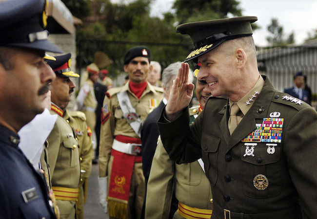 Chairman of the Joint Chiefs of Staff Gen. Peter Pace, U.S. Marine Corps, salutes as he is introduced to a member of the Pakistani Joint Chiefs at the Joint Forces Command in Islamabad, Pakistan, on Mar. 20, 2006. (Photo by Staff Sgt. D. Myles Cullen, U.S. Air Force: Courtesy of WikiCommons)