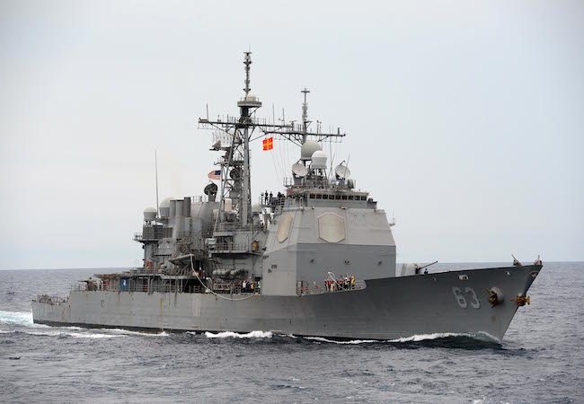 The guided-missile cruiser USS Cowpens (CG 63) maneuvers into position during a replenishment-at-sea. Cowpens is on patrol with the George Washington Carrier Strike Group in the U.S. 7th Fleet area of responsibility supporting security and stability in the Indo-Asia-Pacific region. (Photo by Mass Communication Specialist 3rd Class Declan Barnes: Courtesy of US Navy/WikiCommons)