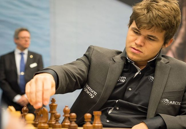 Photo of Magnus Carlsen clinches third consecutive World Chess Championship