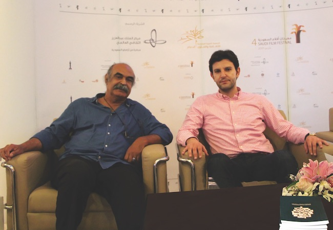 Photo of Woodman discusses poetry with Bahraini poet Qassim Haddad