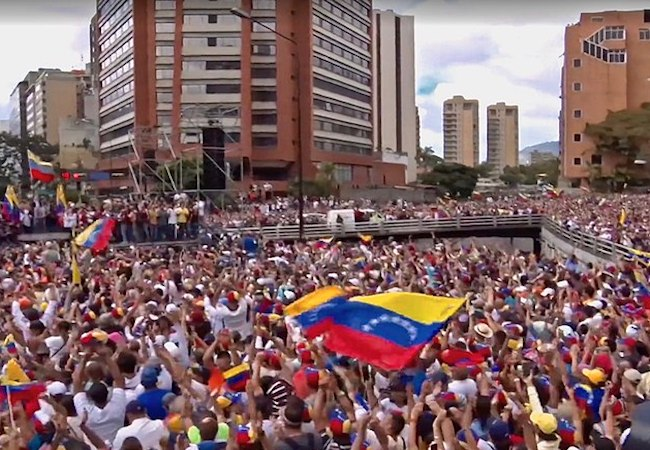 Photo of Venezuela's power struggle reaches a tense stalemate, as human suffering deepens