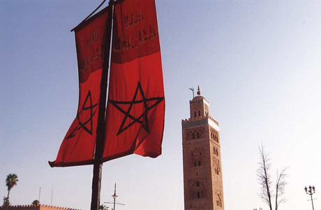 Flag of Morocco and Koutoubia Mosque with its haunting minaret in Marrakesh