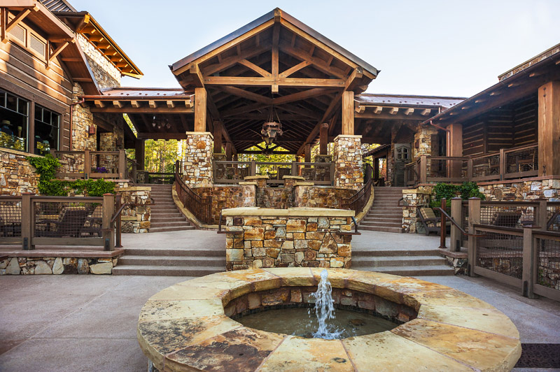 stone and timber golf clubhouse architecture