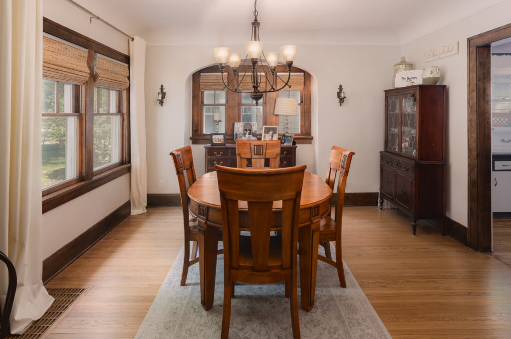 Dining room with restored wood floors and woodwork - Colonial home restoration