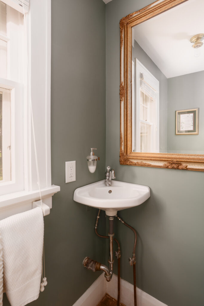 Half bathroom with vintage charm in the historic Colonial home