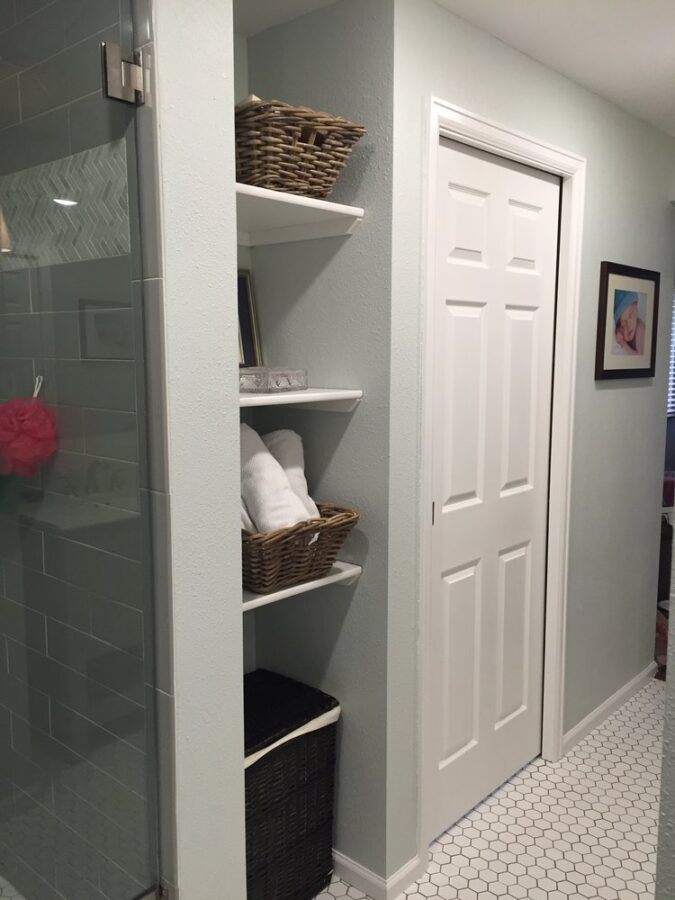 The shelving nook in our master bathroom that offered ample storage and the perfect spot for the clothes hamper.