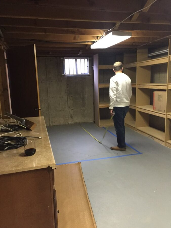 Storage room at our third flip house before the bathroom renovation