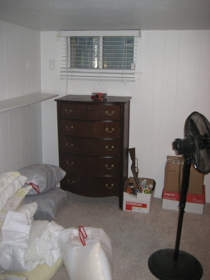The basement bedroom was used for storage by previous owners