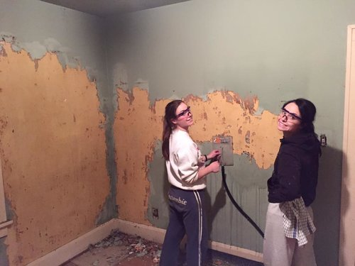 Removing the wallpaper in their fixer upper