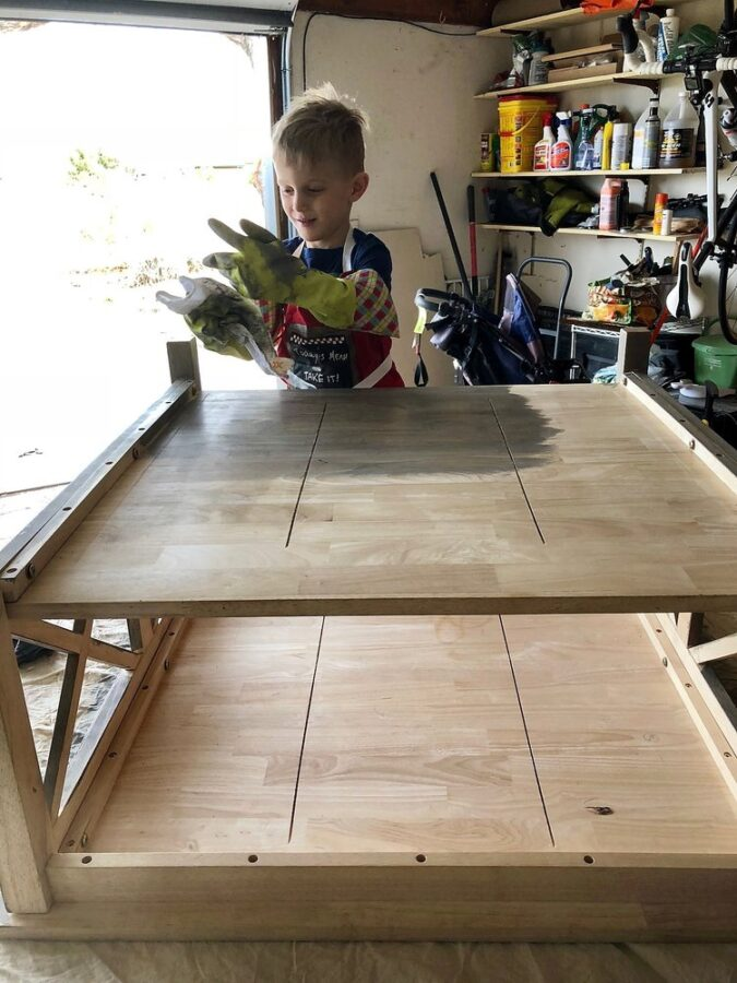 Staining the coffee table with my son.