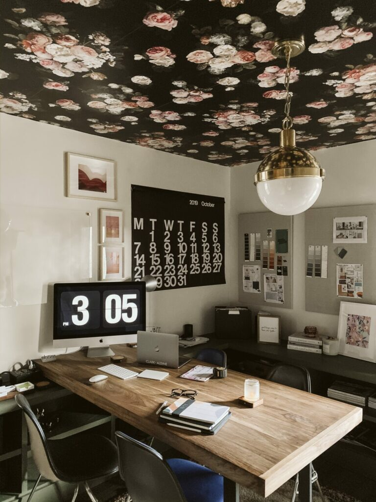Wallpaper on the ceiling adds an element of surprise to the design