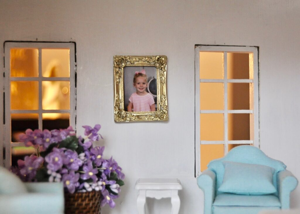 Evelyn's school photo in the living room of the dollhouse