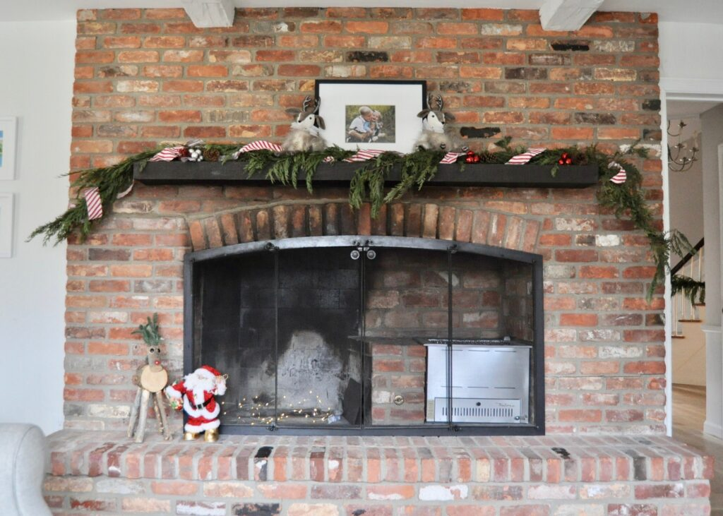 Family room fireplace decorated for Christmas