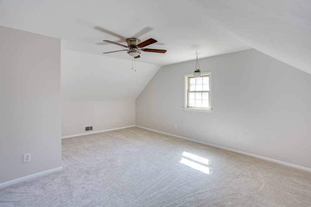 After, the bedroom is fresh with new paint, carpet and a new ceiling fan.