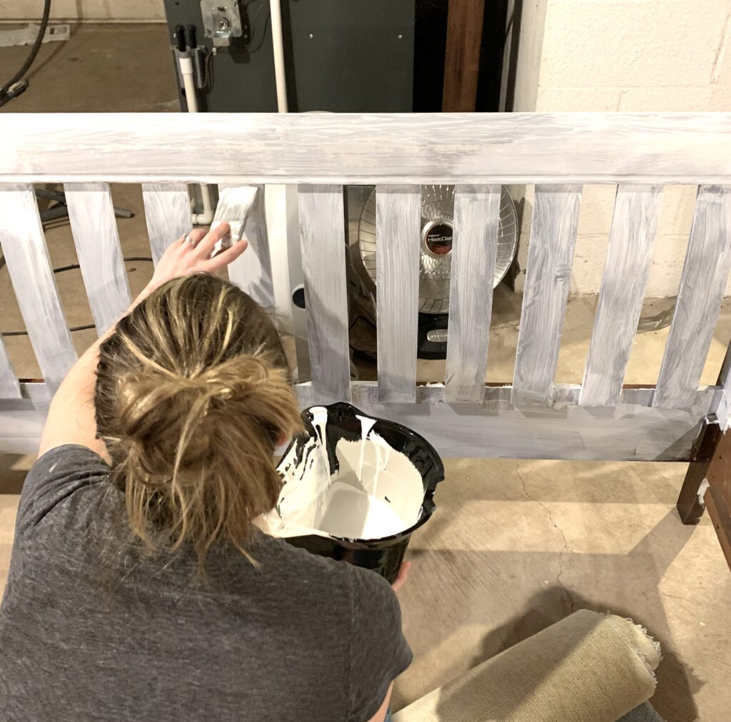 Applying paint primer to a bed frame