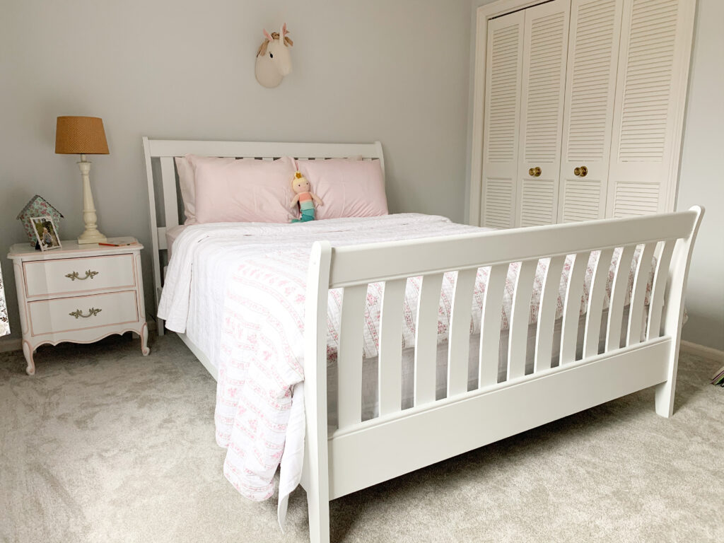 Wooden bed frame painted white