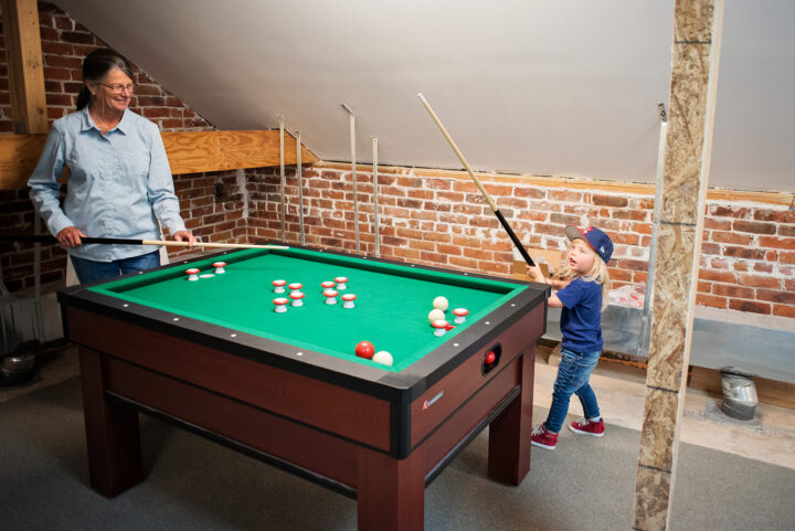 Third floor game room in this historic Victorian-style home