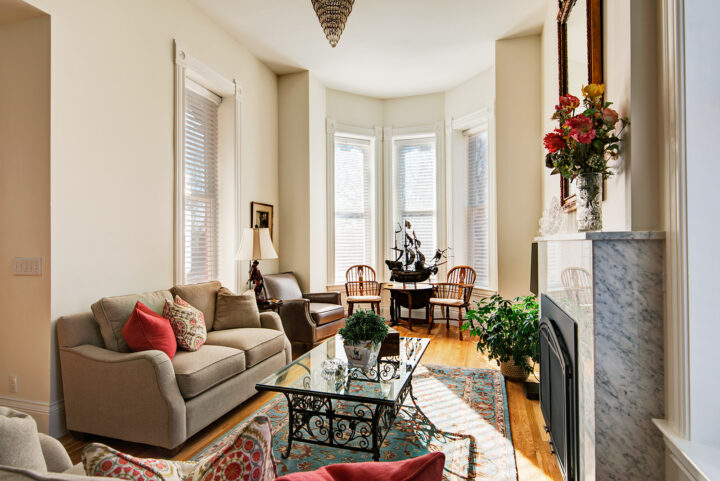 Restored family room in the 1875 Italianate Victorian-style home