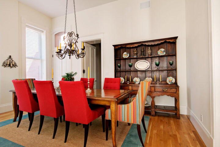 Renovated dining room with antique furniture to complete the look in this historic home