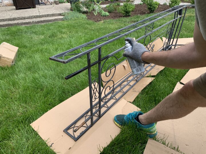 Spraypainting an iron arbor