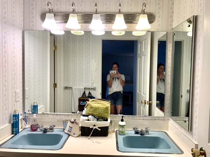 Blue sinks in this 1960's retro bathroom