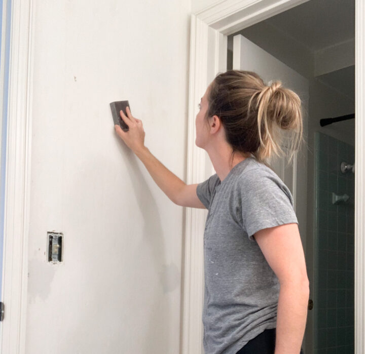 Use a sanding block to smooth out walls before painting | Building Bluebird