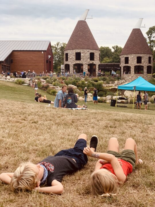 Enjoy a drink at Twin Oast while your kids run around on the property