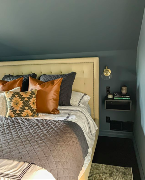 Outerspace by Sherwin Williams gives this bedroom makeover by Clark + Aldine a super cozy vibe | Building Bluebird