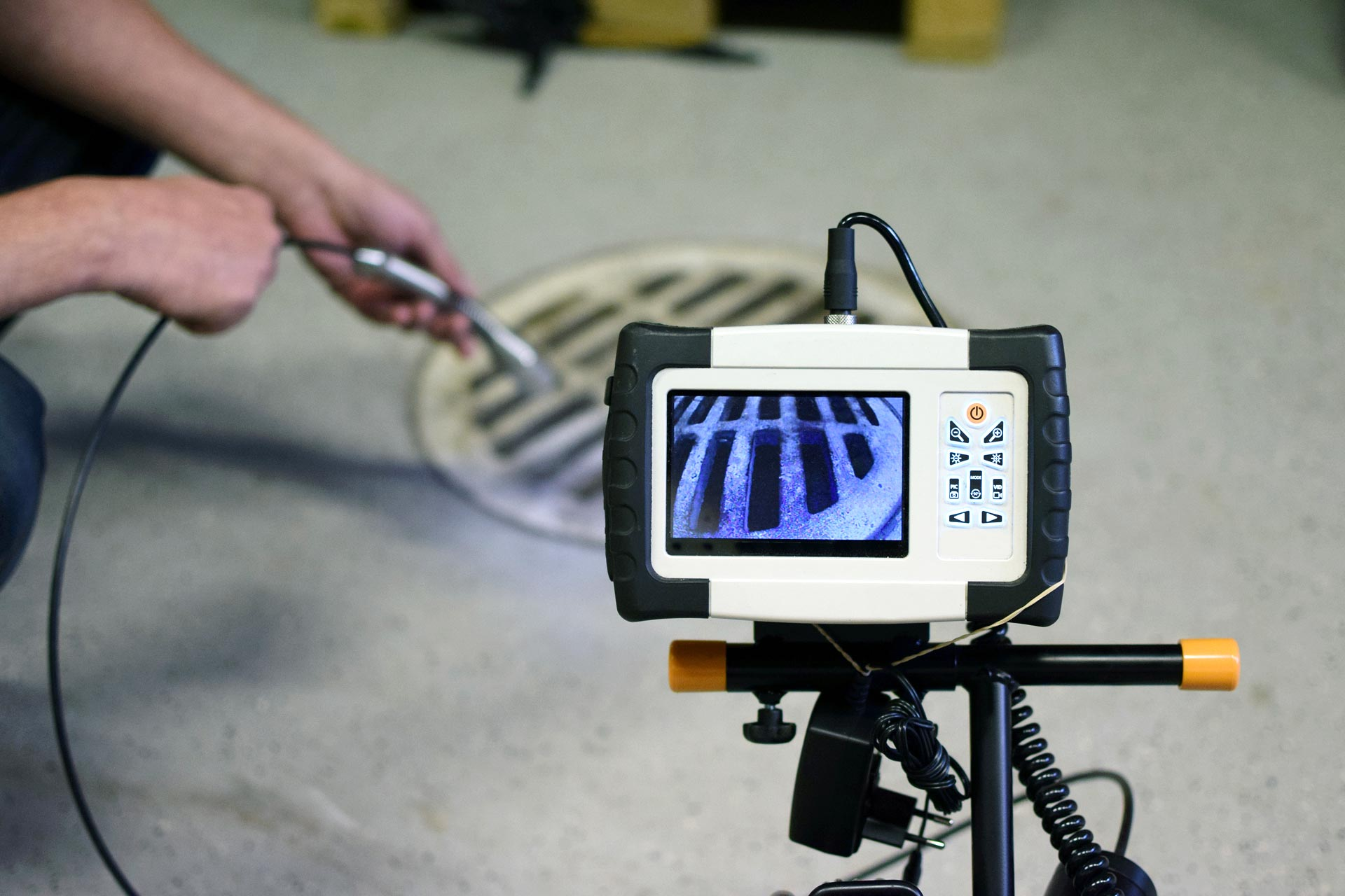 Checking sewer manhole with borescope inspection camera