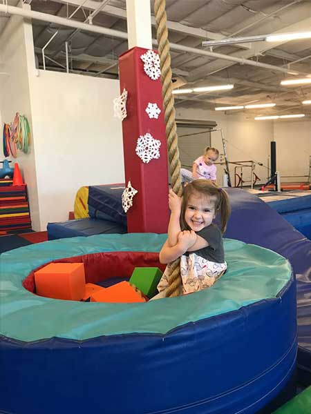 Byers-gymnastics-girl-playing-in-pit