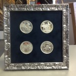 We custom picture frame coins, money, stamps, you name it!