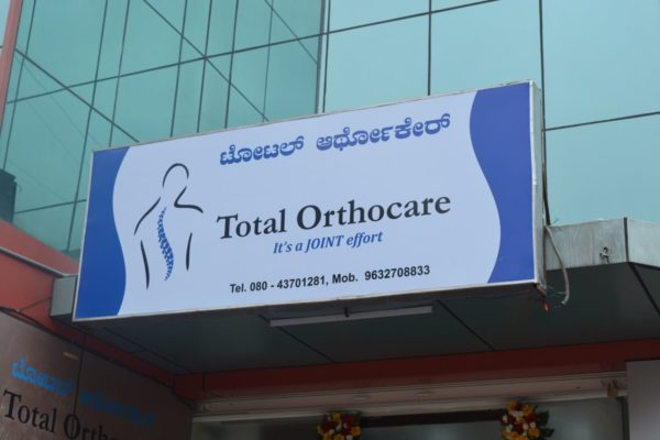 A big sign Board of Total Orthocare Bangalore
