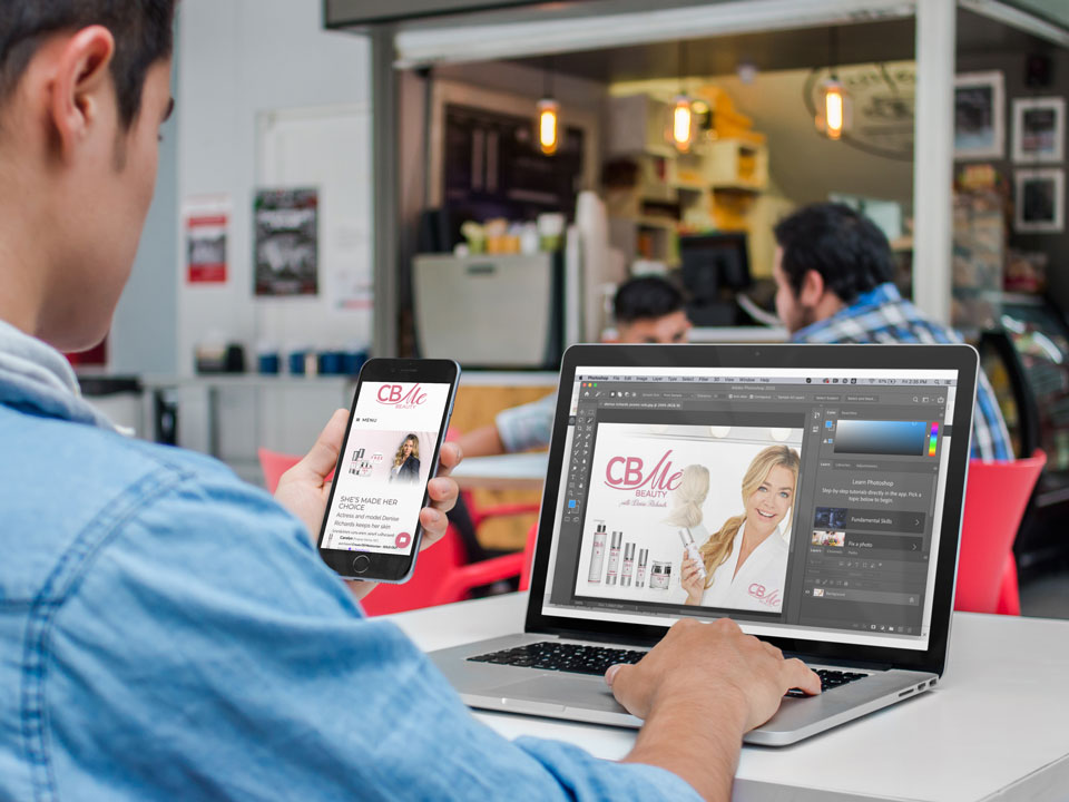 iphone-and-macbook-mockup-of-a-young-man-at-the-cafeteria-a4635