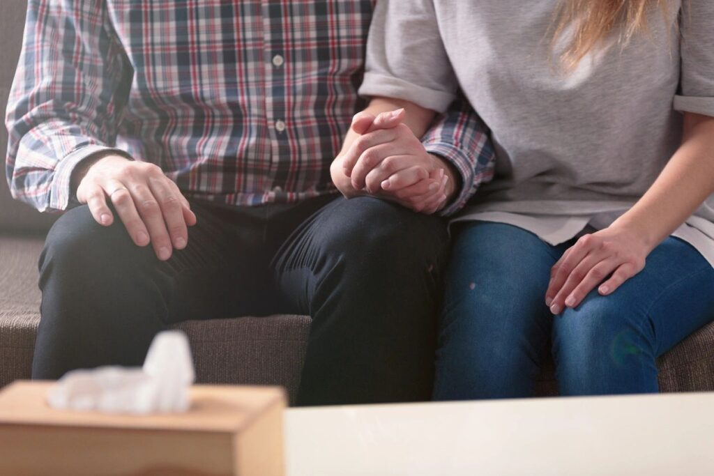 How do couples navigate their safety when one partner goes back to work?