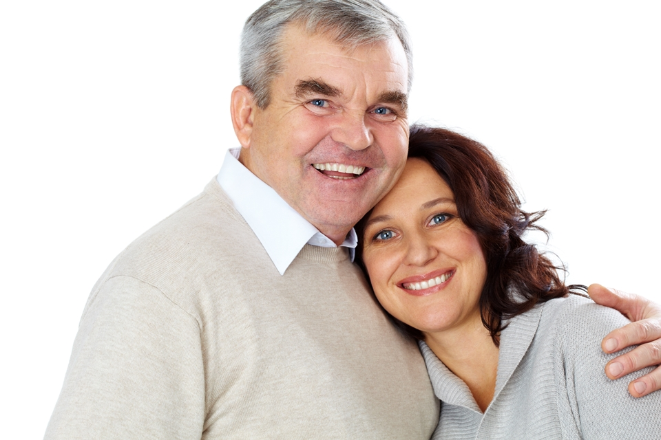 Portrait of happy mature couple looking at camera with smiles