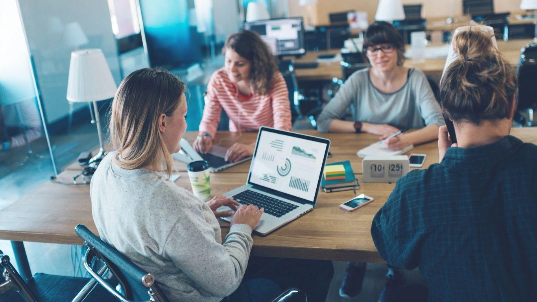 Internship participants sit around table