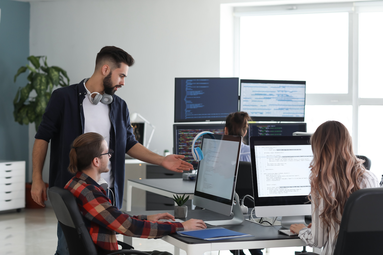 Team of employees working in the office using their computers