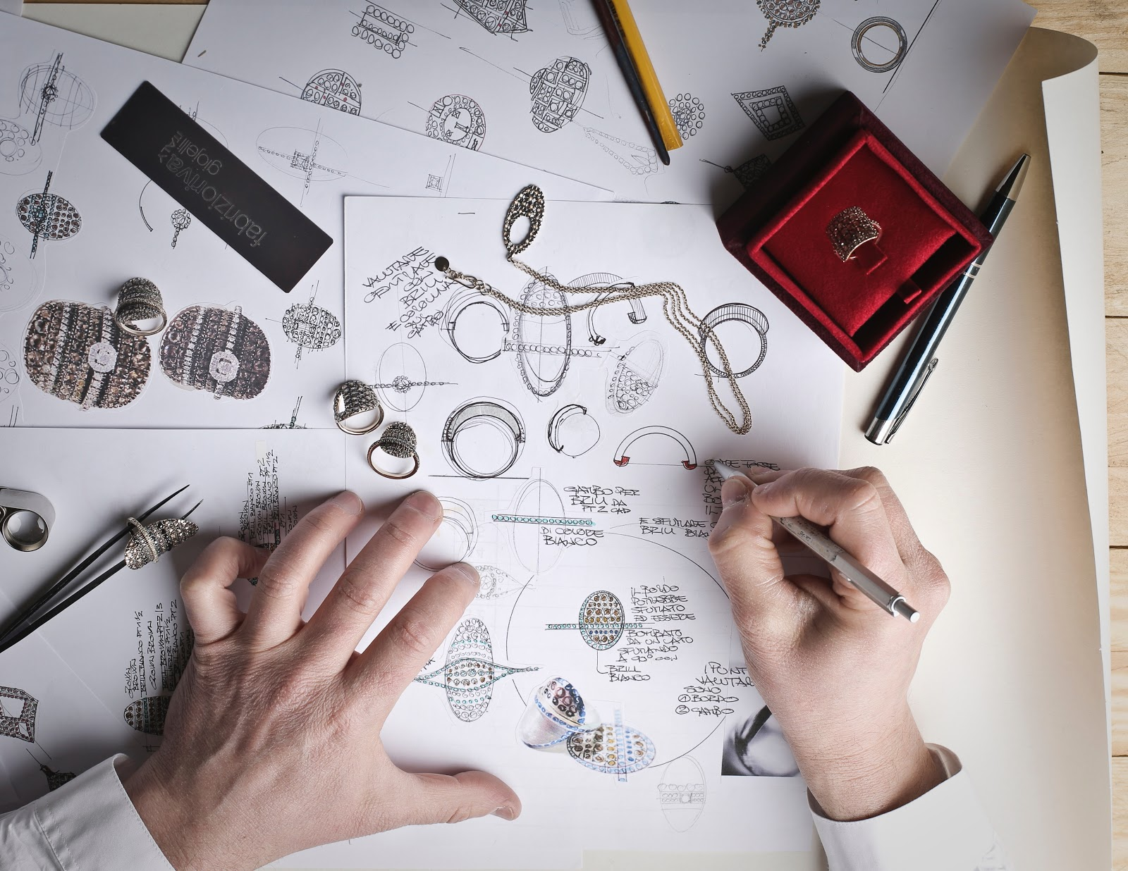 Skills employers look for: Aerial view of hands drawing jewelry