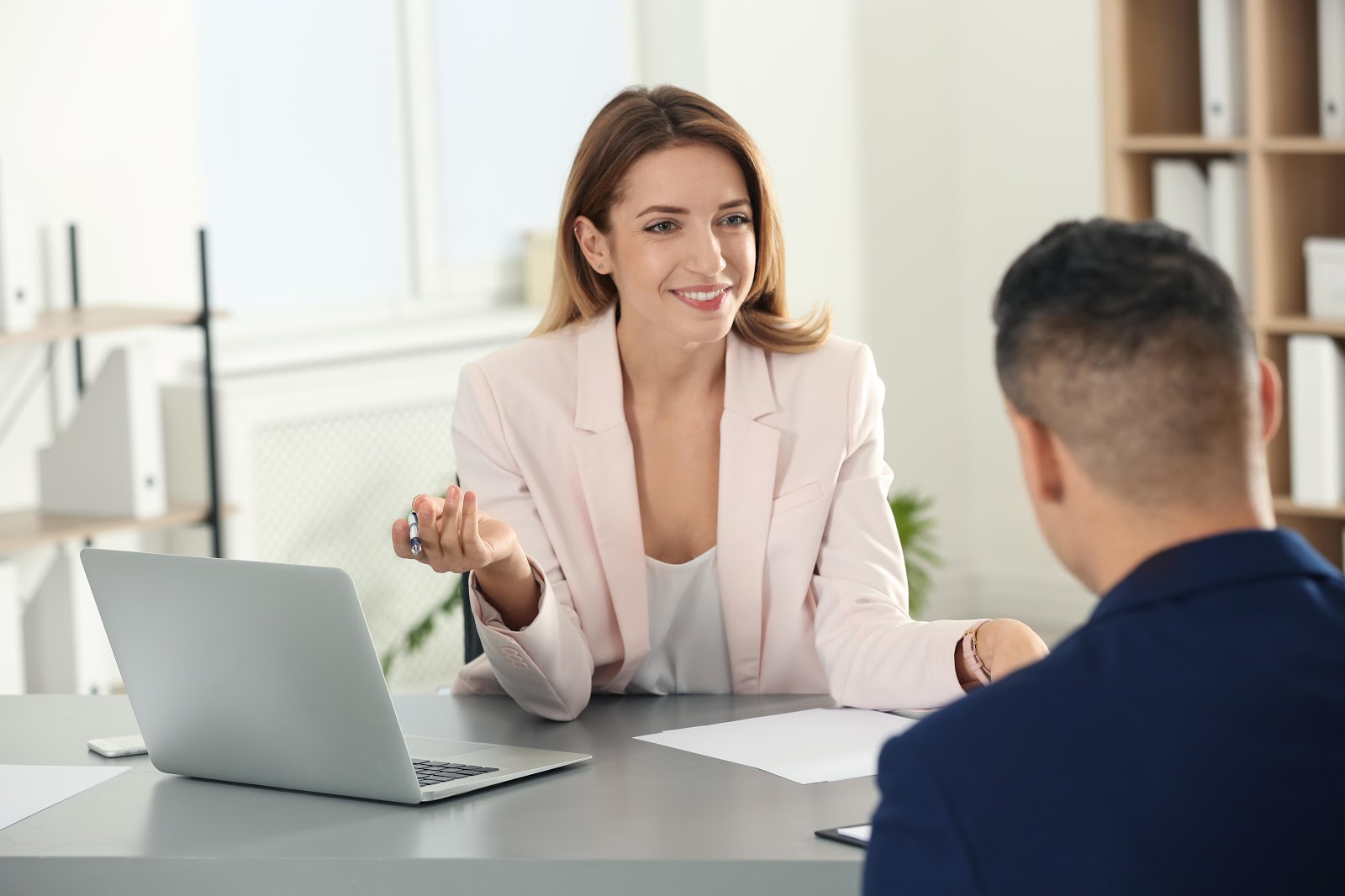 How to Cold Email for an Internship: Woman smiling during an intern interview