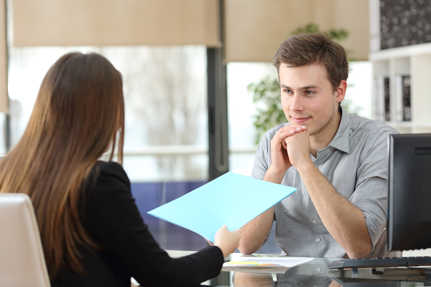 Why hire interns: Businesswoman interviewing a young intern