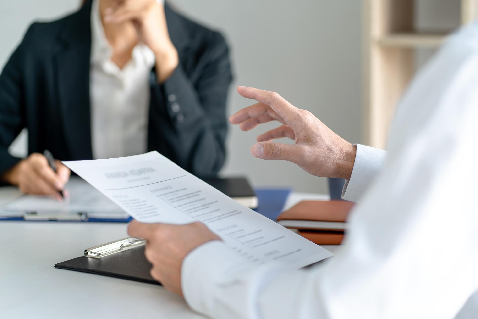 Human Resource Internships: Man reading resume