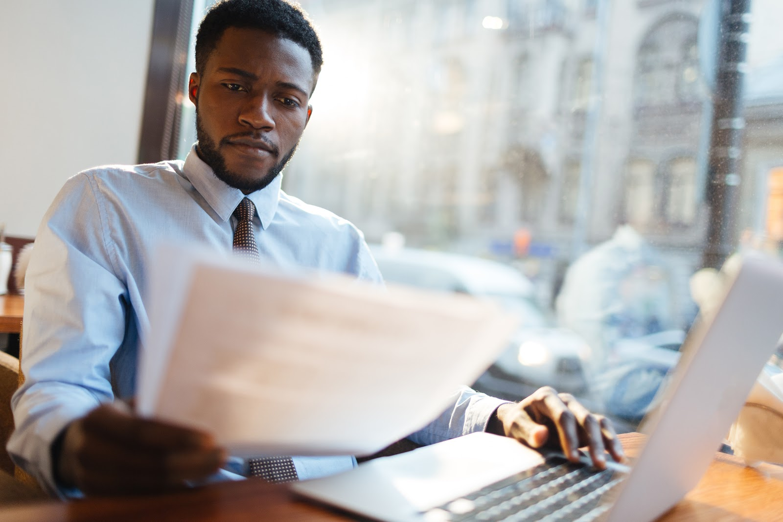 business analyst intern: man reading some documents