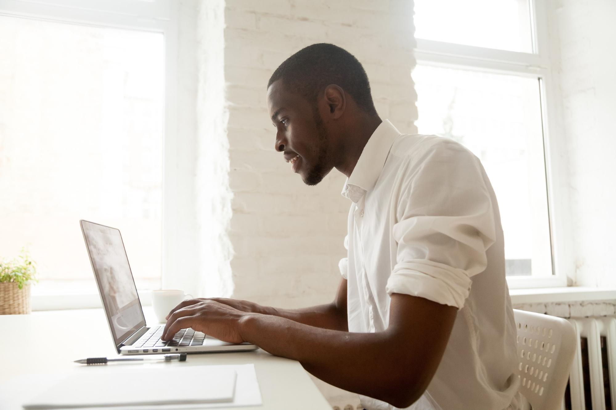 IBM internship: Man typing on a laptop