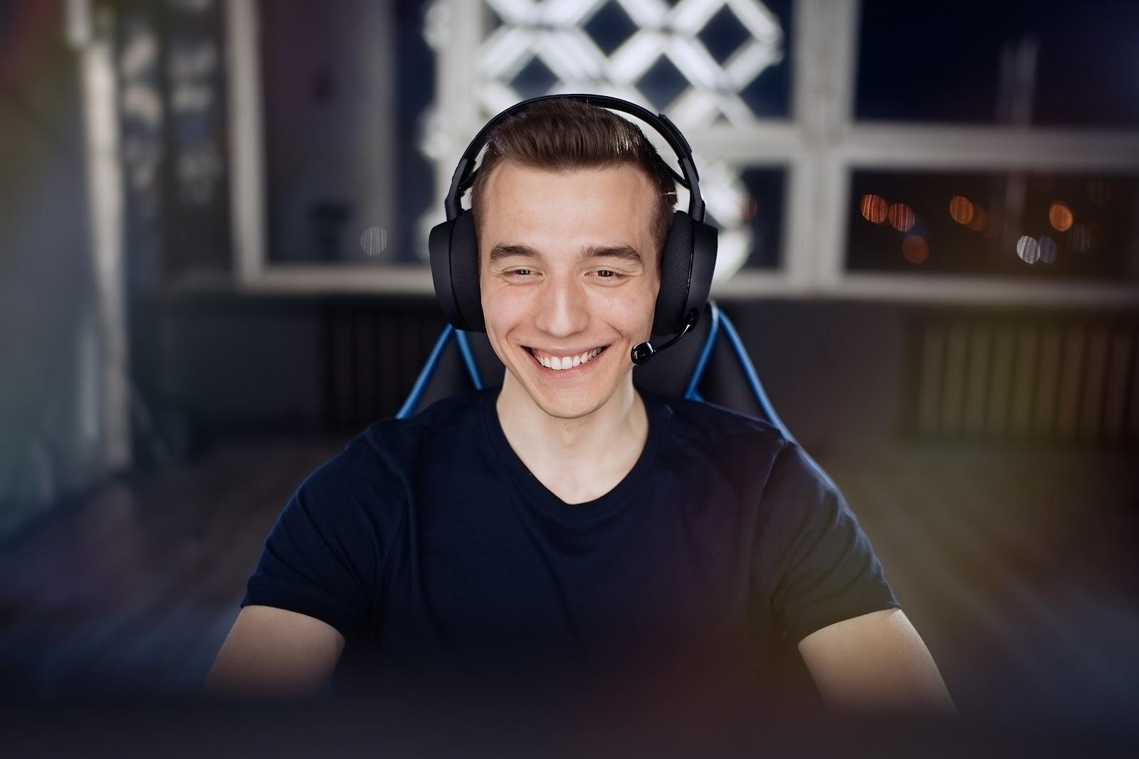 Riot Games internship: Smiling man wearing a headset