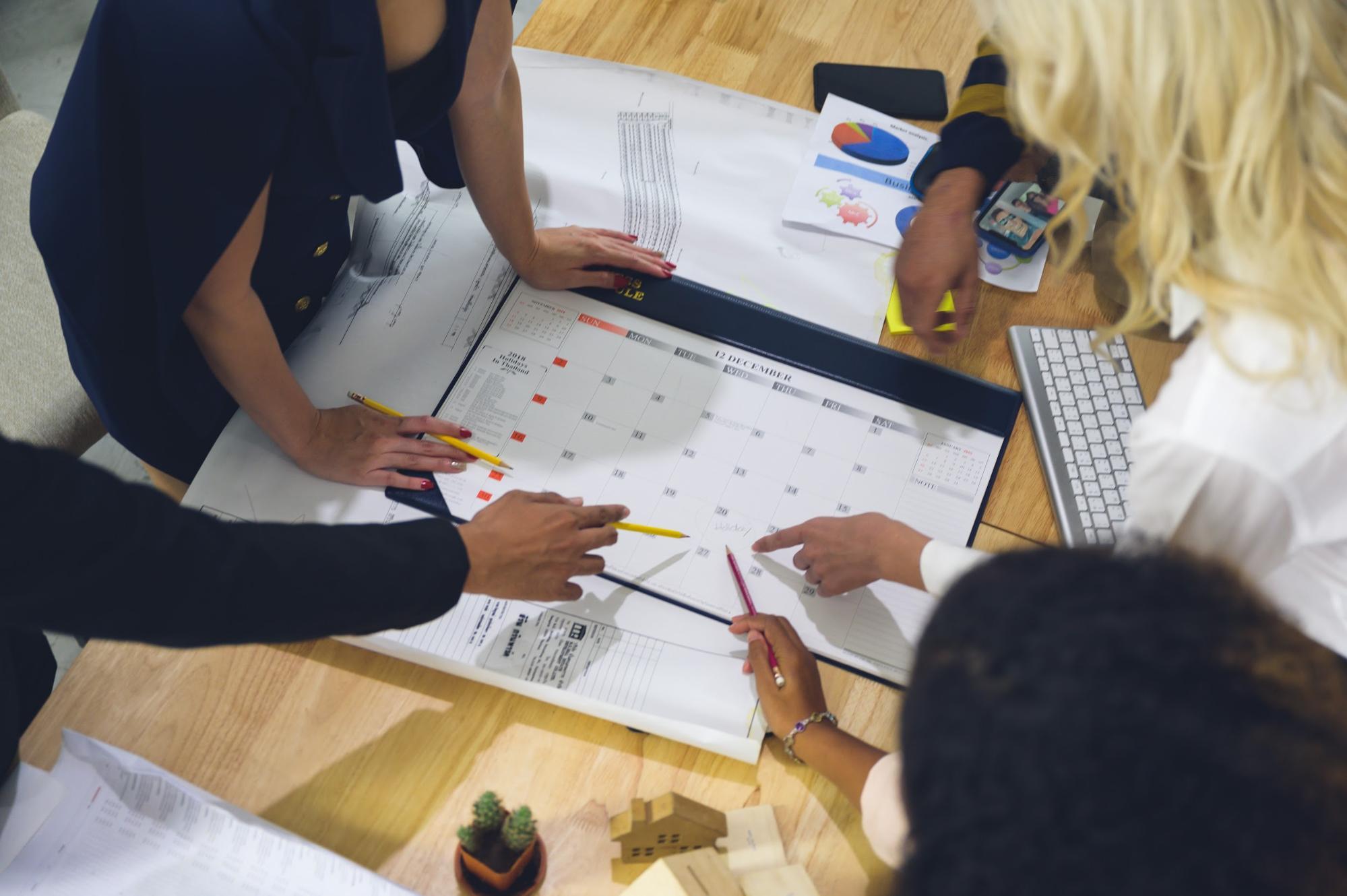 How long is an internship: Workmates discussing calendar schedule