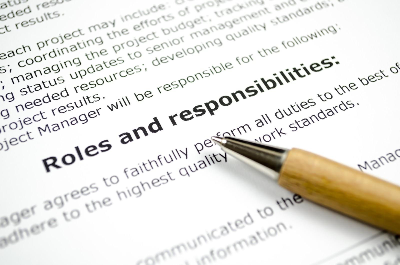 Close up shot of an intern job description with a pen