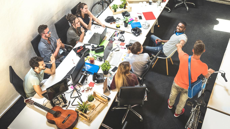 Summer internship: Employees having fun while in a meeting