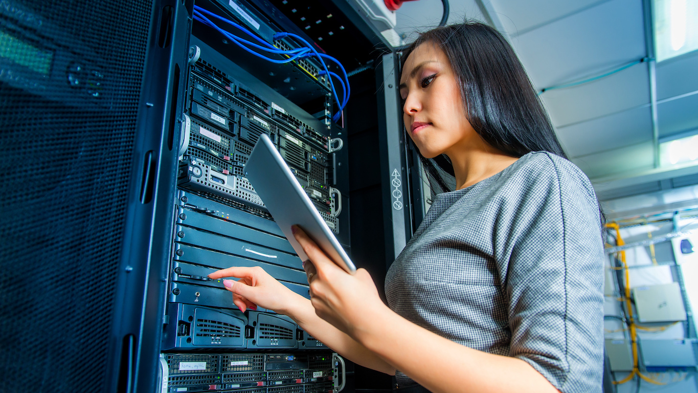 VMware internship: Woman checking her table while in a network server room