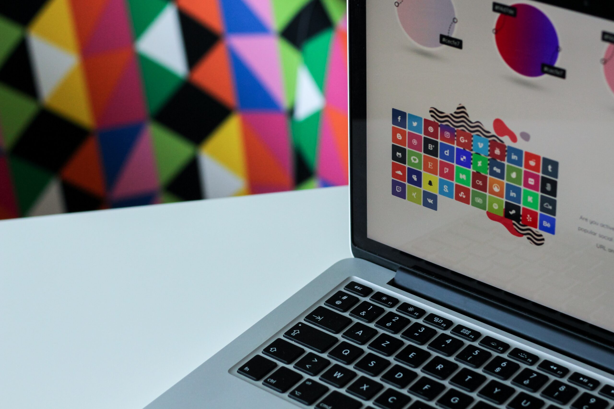Laptop with a design on the screen and a colorful background.